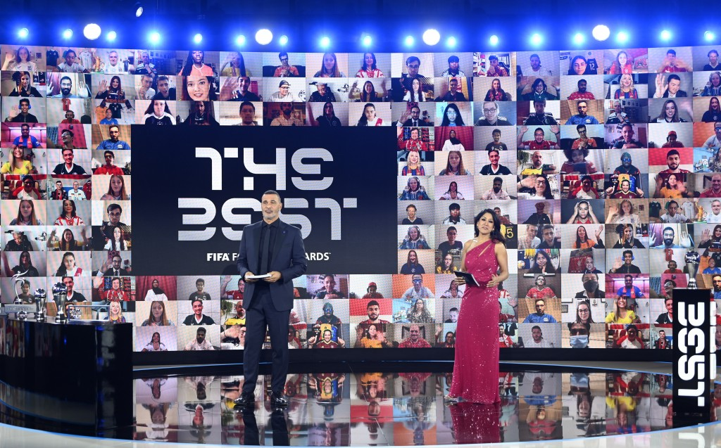 Hosts Reshmin Chowdhury, right, and former Dutch soccer player Ruud Gullit at the start of the Best FIFA Football Awards Ceremony in Zurich, Switzerla...