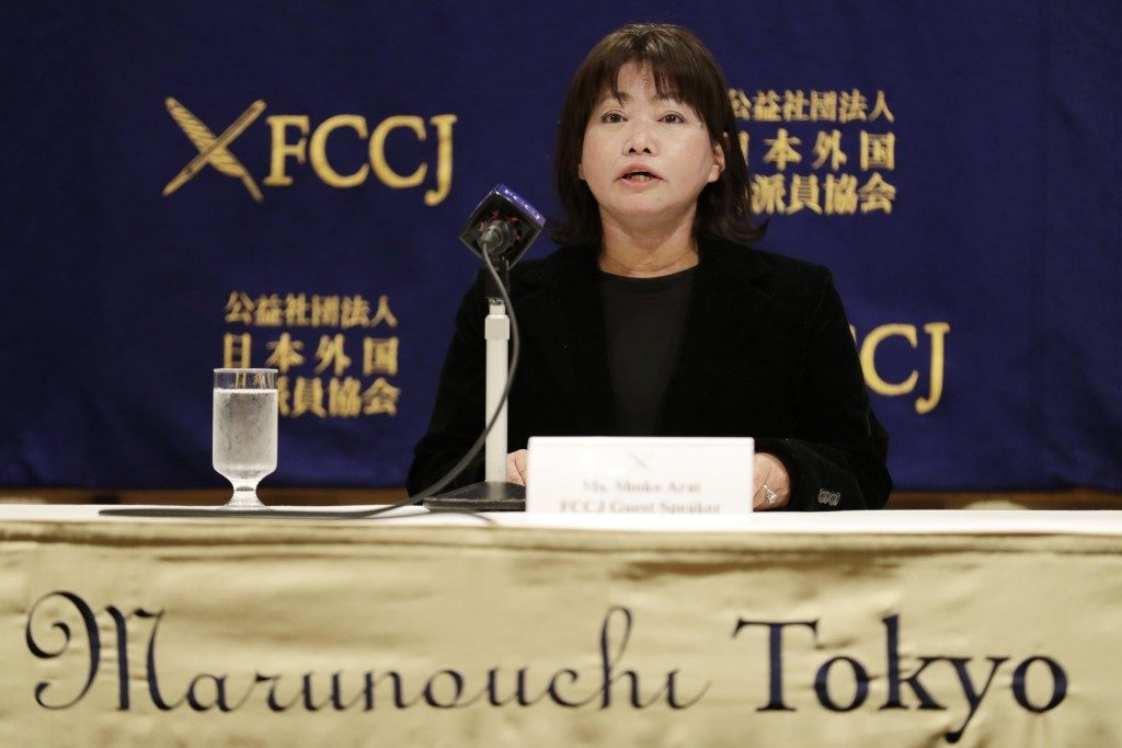 Shoko Arai, a former councilwoman in Kusatsu town, northwest of Tokyo, speaks during a news conference in Tokyo Friday, Dec. 18, 2020. Arai who was ou...
