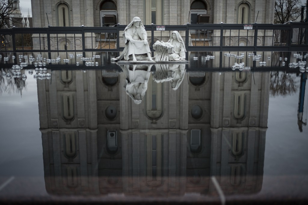 The Salt Lake Temple of The Church of Jesus Christ of Latter-day Saints is seen in a reflection in Salt Lake City, Sunday, Nov. 15, 2020. While the ch...