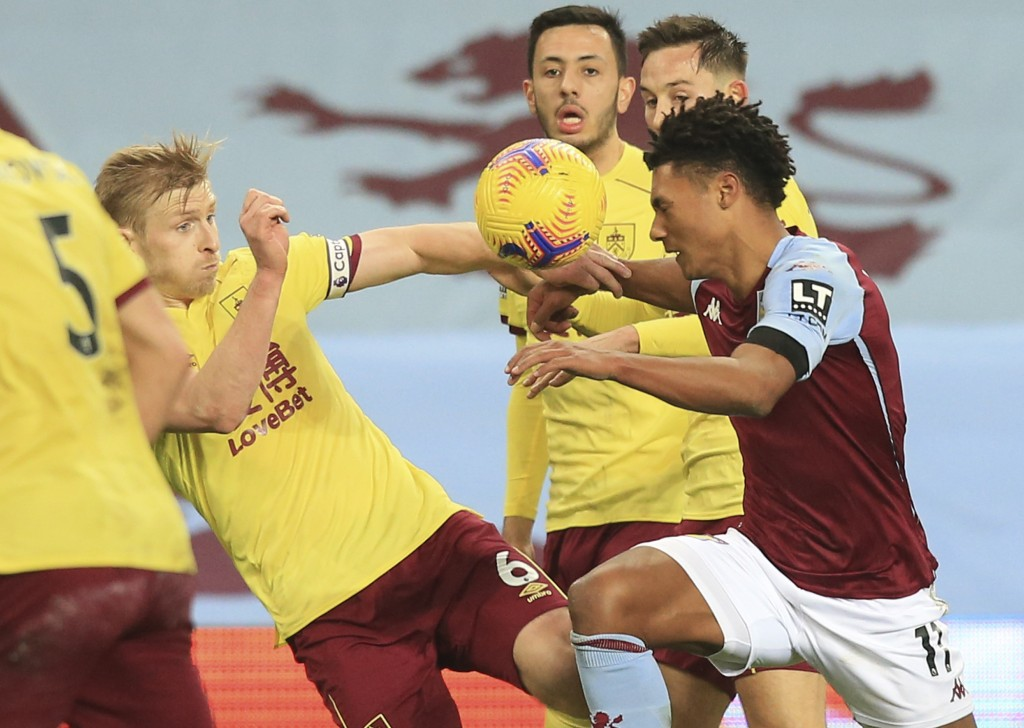 Burnley's Ben Mee, left, and Aston Villa's Ollie Watkins challenge for the ball during the English Premier League soccer match between Aston Villa and...