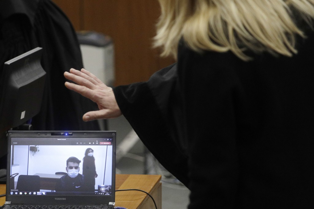 Gabriel Natale-Hjorth, right, connected from the jailhouse to the courtroom, is greeted by his mother Heidi Hjorth, during a hearing in the trial in w...