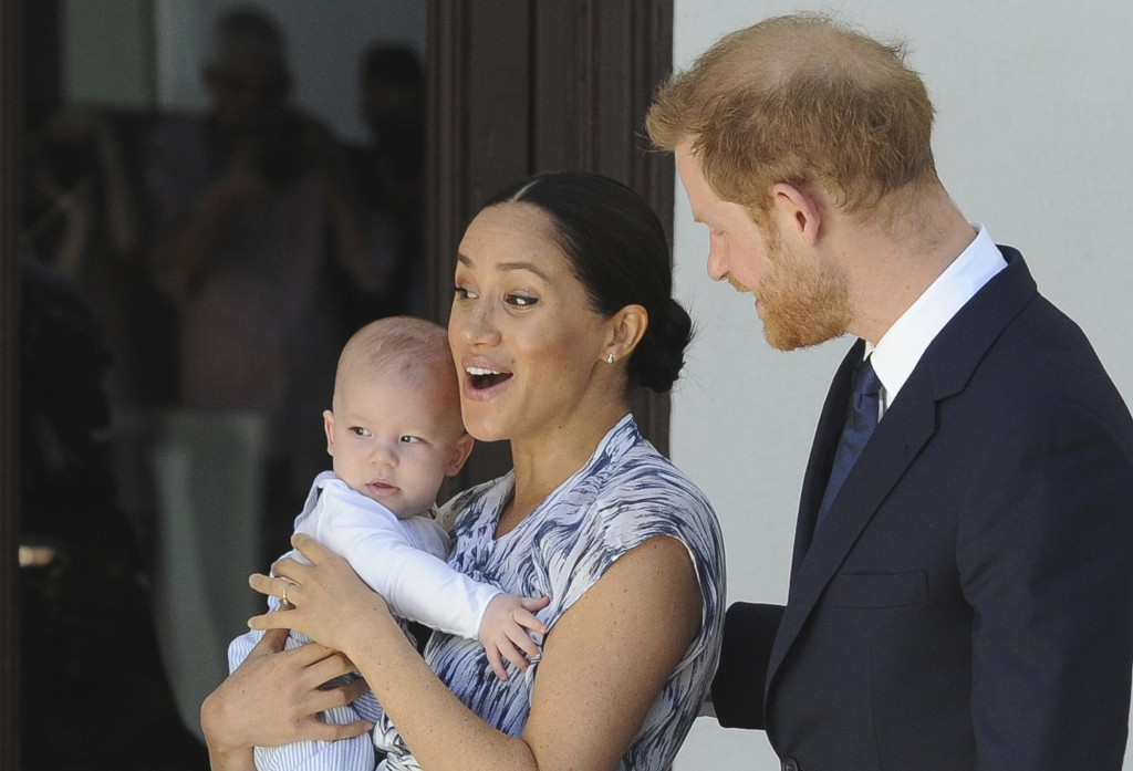 FILE - In this Wednesday, Sept. 25, 2019 file photo, Britain's Prince Harry and Meghan, Duchess of Sussex, holding their son Archie, meet with Anglica...