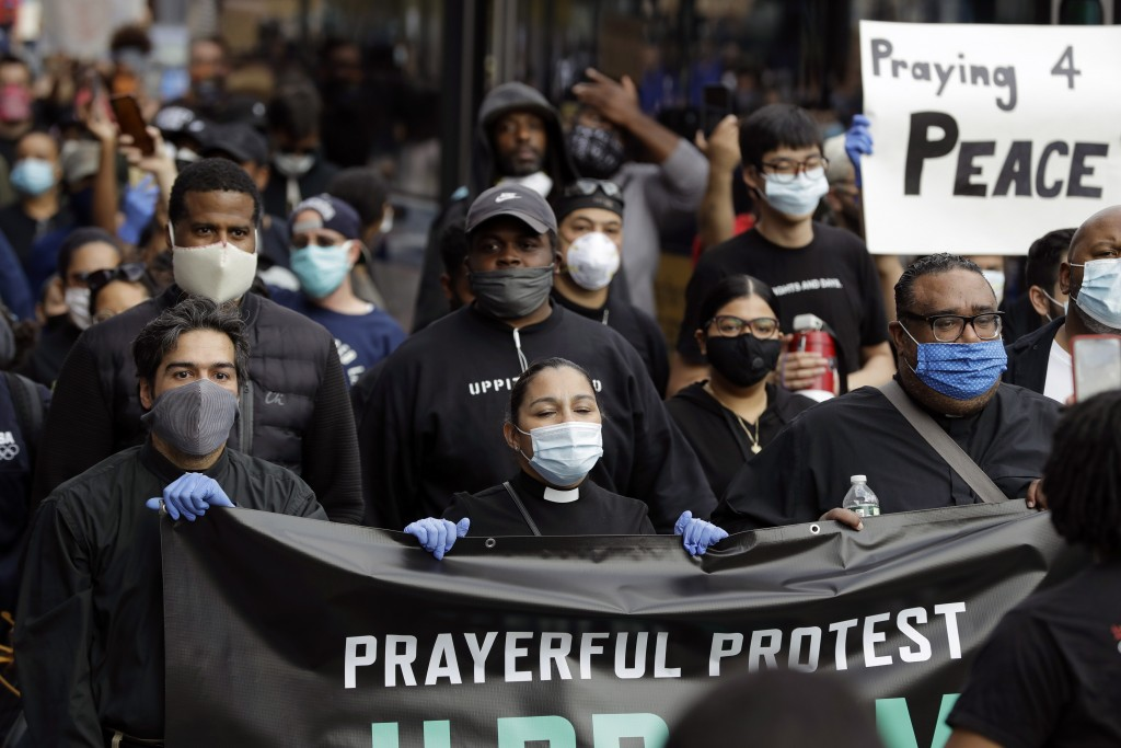 FILE - In this Tuesday, June 2, 2020 file photo, members of the clergy lead protesters in the Prayerful Protest march for George Floyd, in the Brookly...