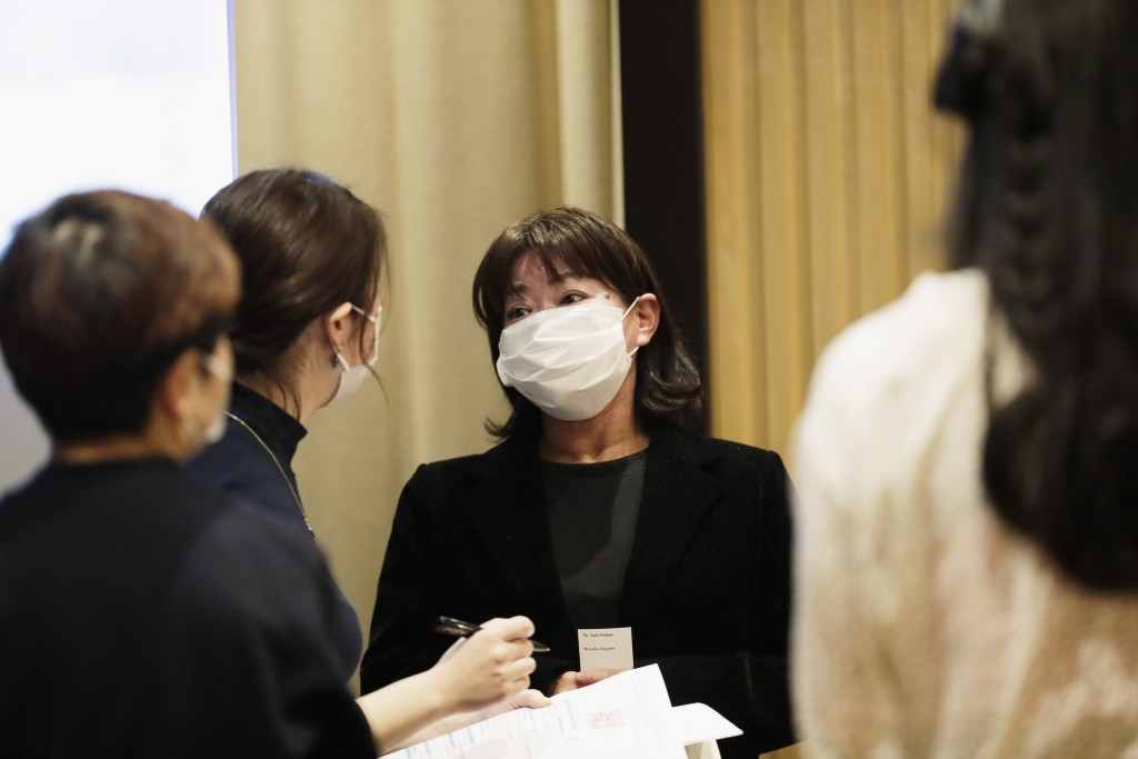 Shoko Arai, a former councilwoman in Kusatsu town, northwest of Tokyo, takes a question from a reporter after a news conference in Tokyo Friday, Dec. ...