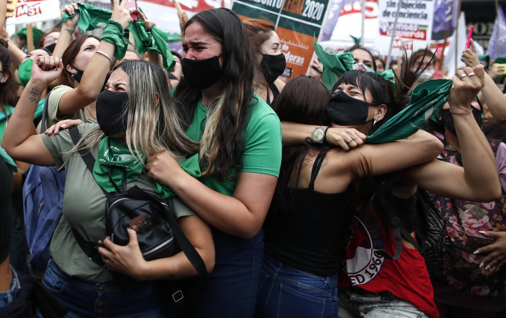 Abortion-rights activists celebrate as Argentine lower house approves a bill that would legalize abortion outside Congress in Buenos Aires, Argentina,...