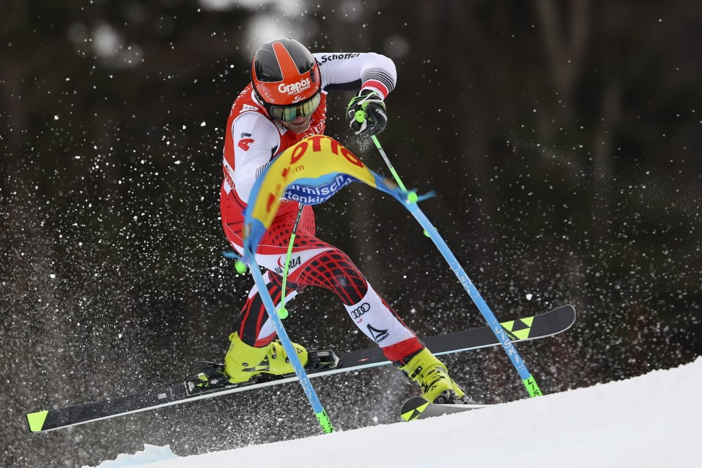 Austria's Roland Leitinger loses control as he competes in an alpine ski, men's World Cup giant slalom, in Garmisch Partenkirchen, Germany, Sunday, Fe...