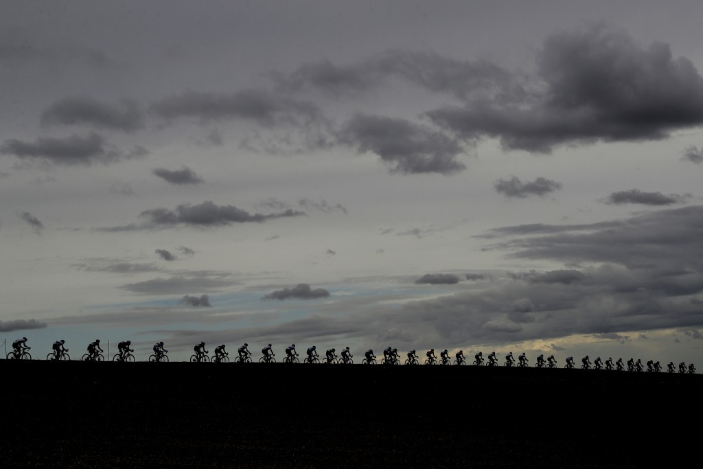 Riders pedal under a cloudy sky during the men's elite event, at the road cycling World Championships, in Imola, Italy, Sunday, Sept. 27, 2020. (AP Ph...