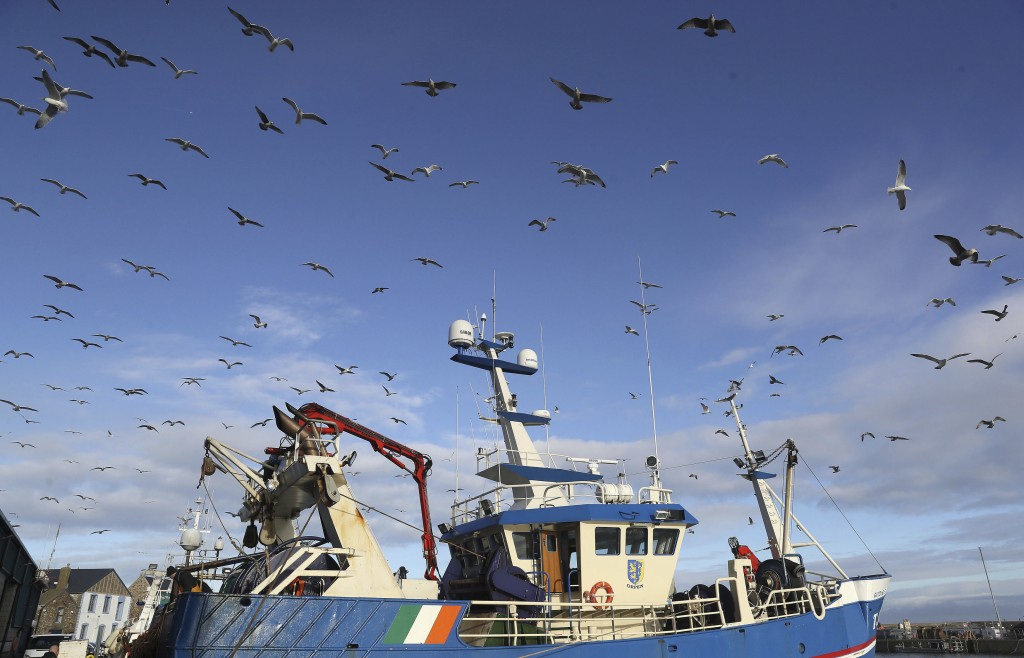 "A fishing vessel comes into the harbour in the fishing village of Howth, Dublin, Ireland, Thursday, Dec. 17, 2020. Irish coastal communities will be ""..."