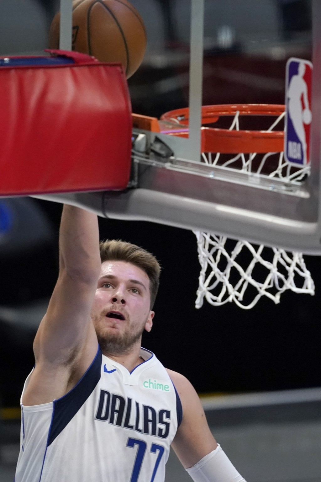 Dallas Mavericks guard Luka Doncic goes up for a shot in the first half of an NBA preseason basketball game against the Minnesota Timberwolves in Dall...
