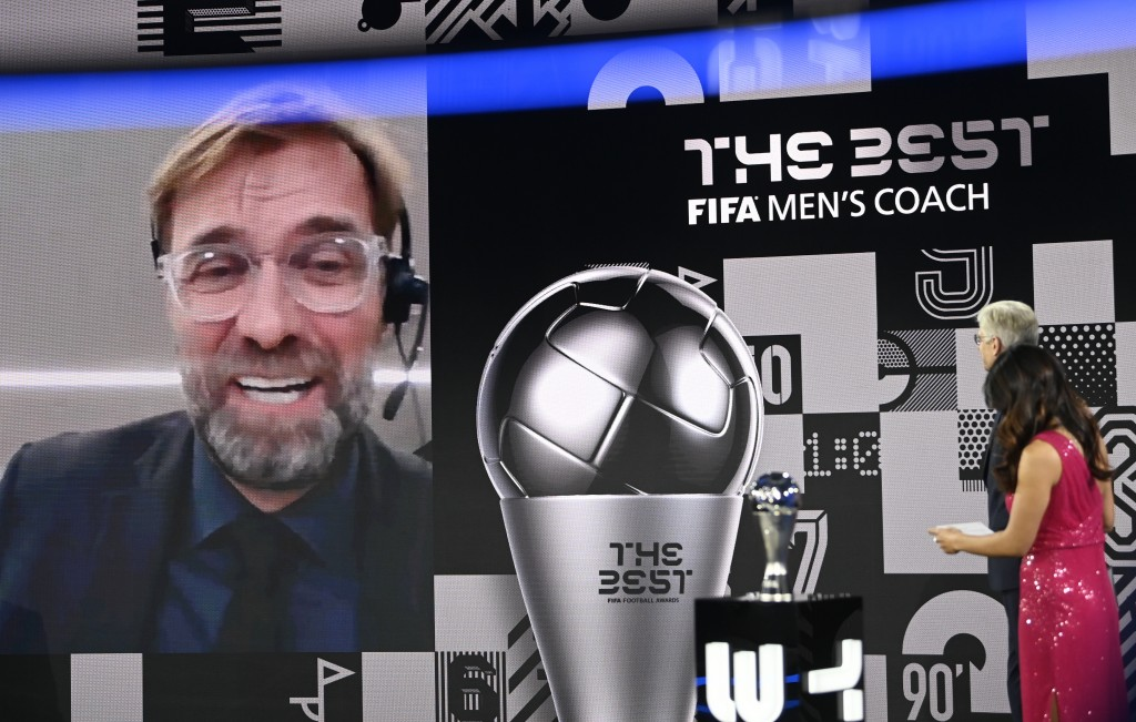 Liverpool's manager Jurgen Klopp smiles after being awarded as Men's coach of the year during the Best FIFA Football Awards Ceremony in Zurich, Switze...