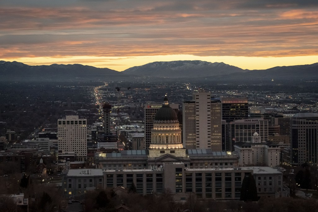 The Utah State Capitol is illuminated against the setting sun in Salt Lake City, Sunday, Nov. 15, 2020. Utah is a place where right-wing Republicans h...