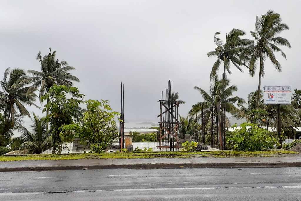 The sky is clouded over in the distance as intermittent rain and wind continue at Suva Harbour in Suva, Fiji,  Friday, Dec. 18, 2020. Dozens of homes ...