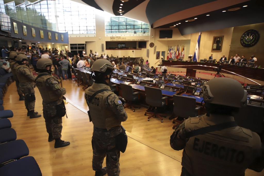 FILE - In this Feb. 9, 2020 file photo, armed Special Forces soldiers of the Salvadoran Army, following orders of President Nayib Bukele, enter congre...