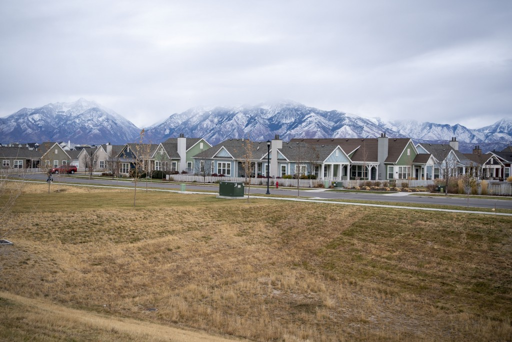Homes line up against the backdrop of snow capped mountains in South Jordan, Utah, Sunday, Nov. 15, 2020. Founded by believers in what was then a smal...
