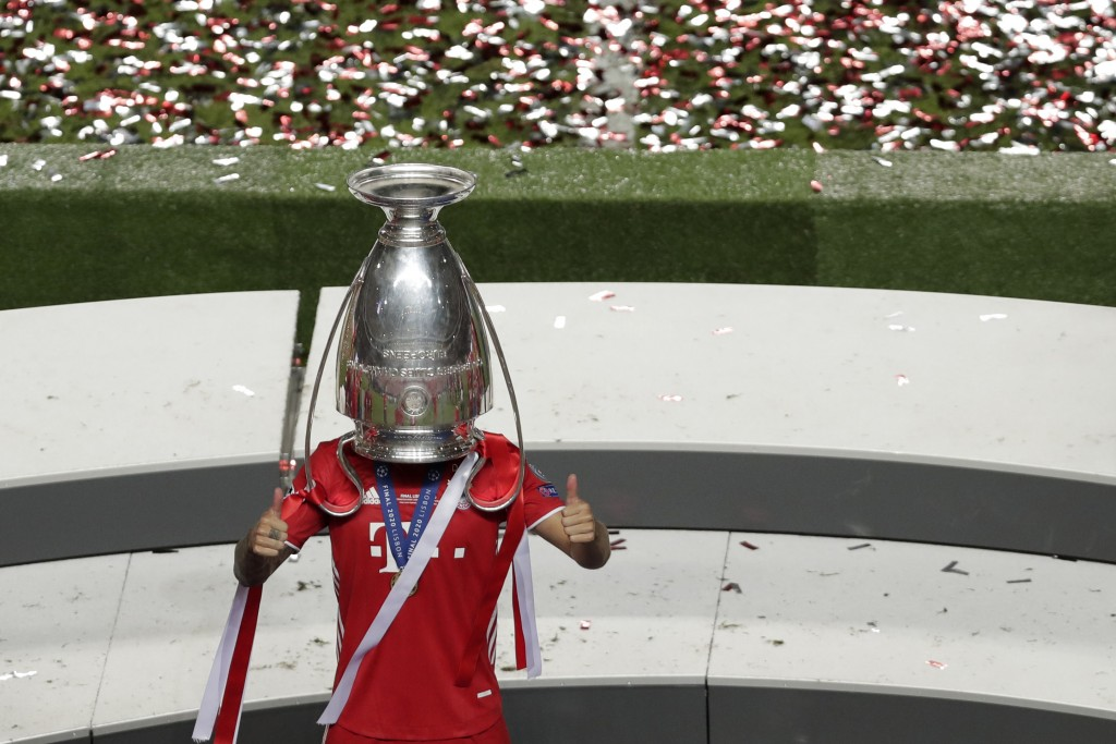 Bayern's Lucas Hernandez celebrates with the trophy after the Champions League final soccer match between Paris Saint-Germain and Bayern Munich at the...
