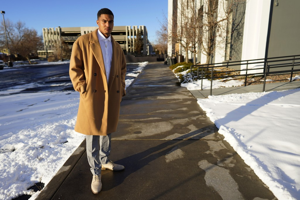 Donte Westmoreland poses for a photo outside a hotel Tuesday, Dec. 15, 2020, in southeast Denver. Westmoreland was recently released from Lansing Corr...