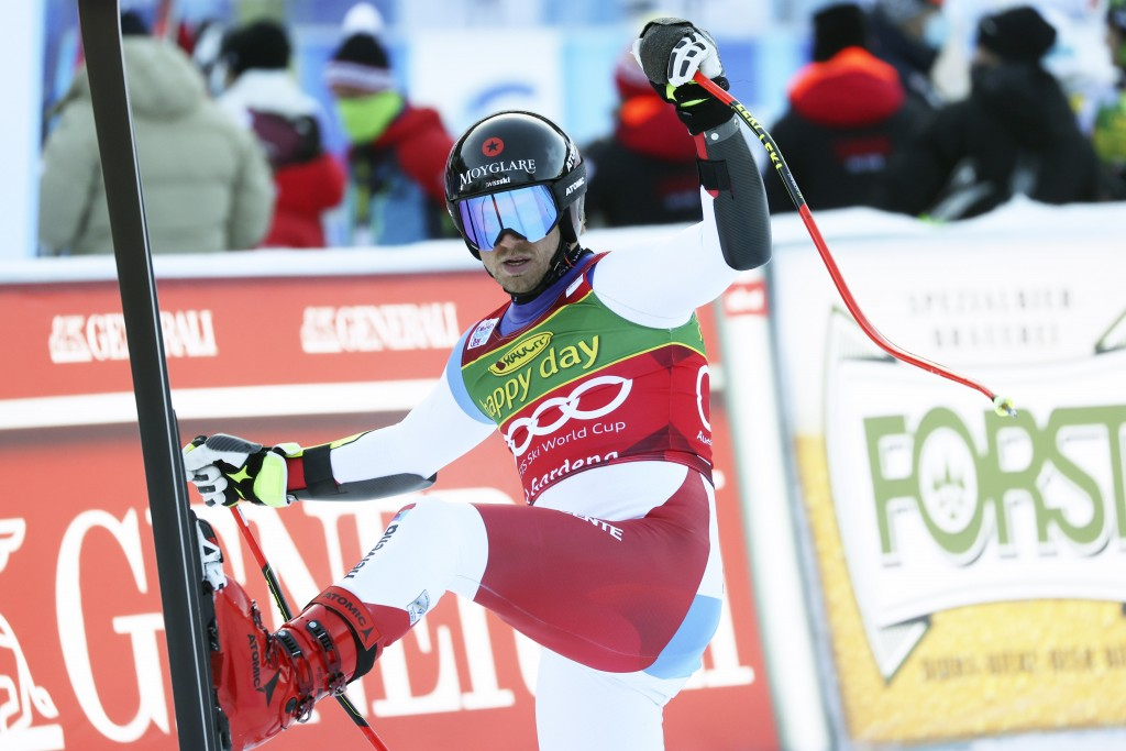 Switzerland's Mauro Caviezel arrives at the finish area during an alpine ski, men's World Cup super-G, in Val Gardena, Italy, Friday, Dec. 18, 2020. (...