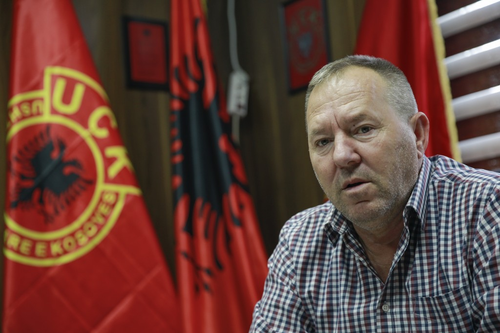 FILE- In this Thursday Sept. 24, 2020, file photo Hysni Gucati head of the War Veterans Organization of the Kosovo Liberation Army speaks during an in...