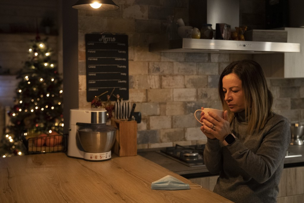 Nurse Glenda Grossi drinks a cappuccino in her kitchen early Sunday Dec. 13, 2020 at her house in the outskirts of Rome while her husband Maurizio Di ...