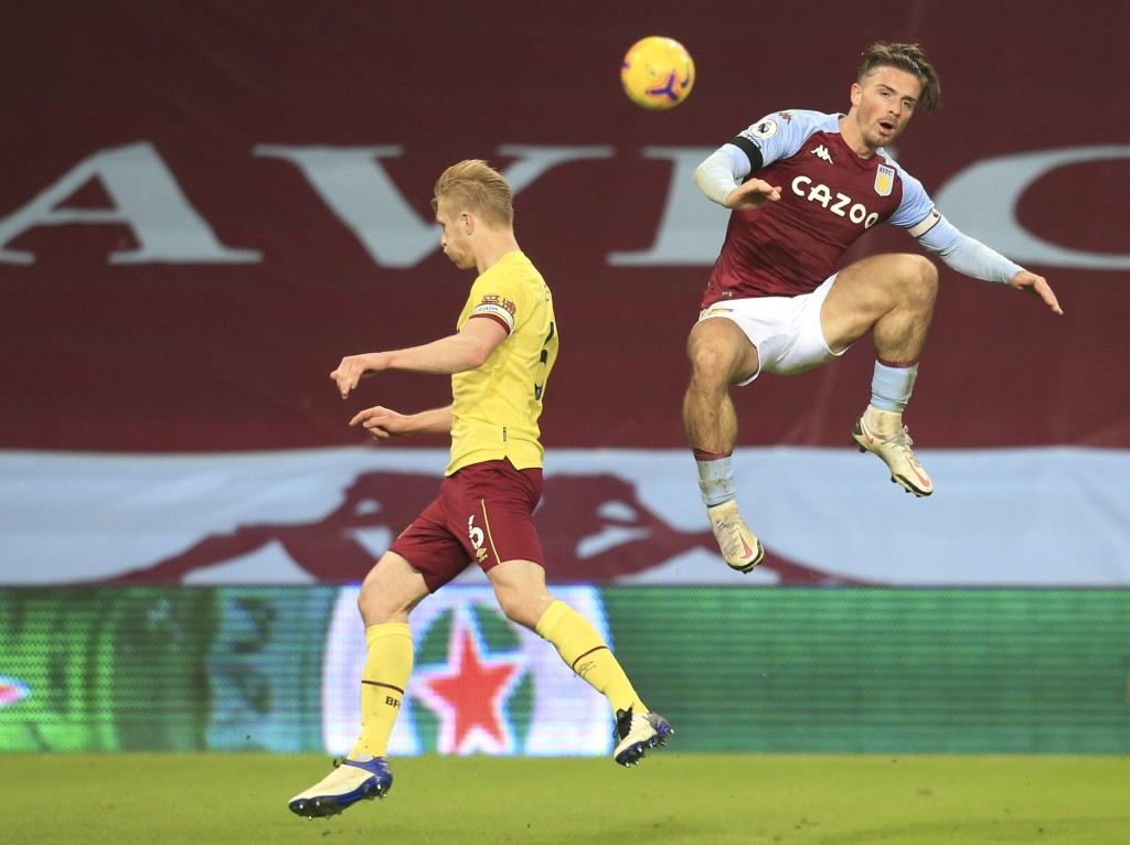 Burnley's Ben Mee, left, and Aston Villa's Jack Grealish challenge for the ball during the English Premier League soccer match between Aston Villa and...