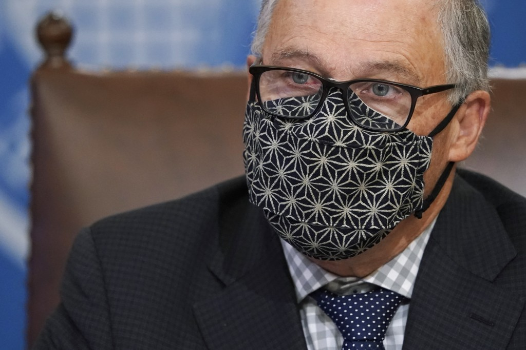 FILE - Washington Gov. Jay Inslee wears a mask as he speaks during a news conference, Monday, Nov. 30, 2020, at the Capitol in Olympia, Wash.  Several...