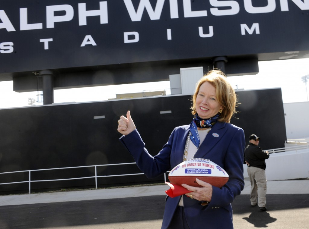 FILE - In this Sept. 14, 2014, file photo, Mary Wilson, wife of late Buffalo Bills owner Ralph C. Wilson, holds a game ball for stadium construction w...