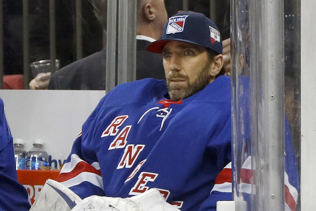 FILE - Then-New York Rangers goaltender Henrik Lundqvist looks on from the bench during an NHL hockey game against the Buffalo Sabres in New York, in ...