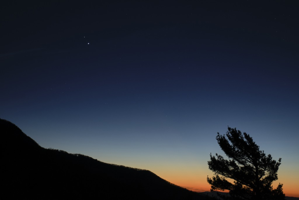 In this Sunday, Dec. 13, 2020 photo made available by NASA, Saturn, top, and Jupiter, below, are seen after sunset from Shenandoah National Park in Lu...