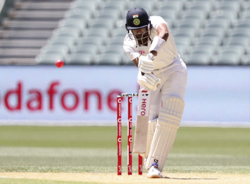 India's Ravichandran Ashwin edges the ball and is caught behind by Australia for 15 runs on the second day of their cricket test match at the Adelaide...