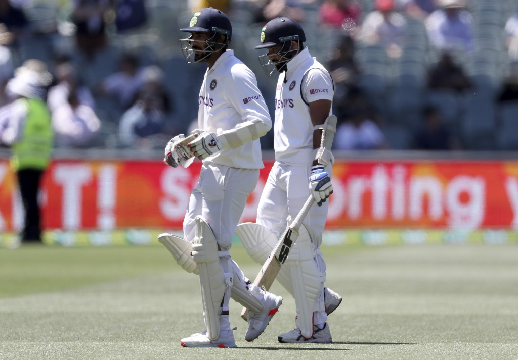 India's Jasprit Bumrah, left, and Mohammed Shami walk off after the end of India's first innings against Australia on the second day of their cricket ...