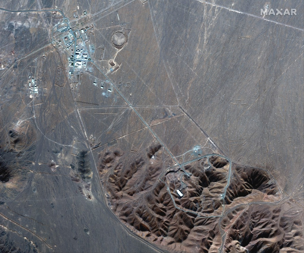 This Nov. 4, 2020, satellite photo by Maxar Technologies shows Iran's Fordo nuclear site. Iran has begun construction on a site at its underground nuc...