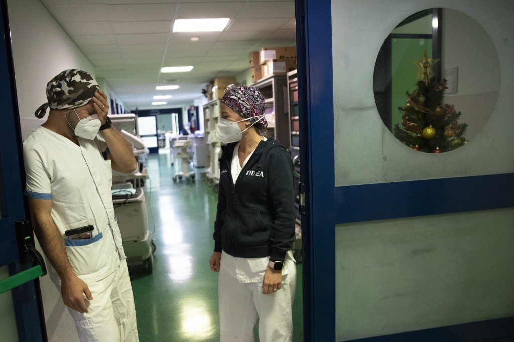 Nurses Glenda Grossi, right, talks with her husband Maurizio di Giacobbe at the end of her shift in the COVID-19 ICU of the Tor Vergata Polyclinic Hos...
