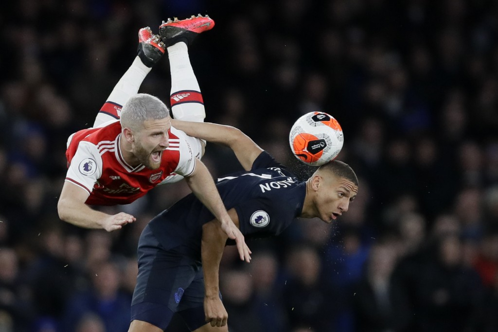 Everton's Richarlison, right, fights for the ball with Arsenal's Shkodran Mustafi during the English Premier League soccer match between Arsenal and E...