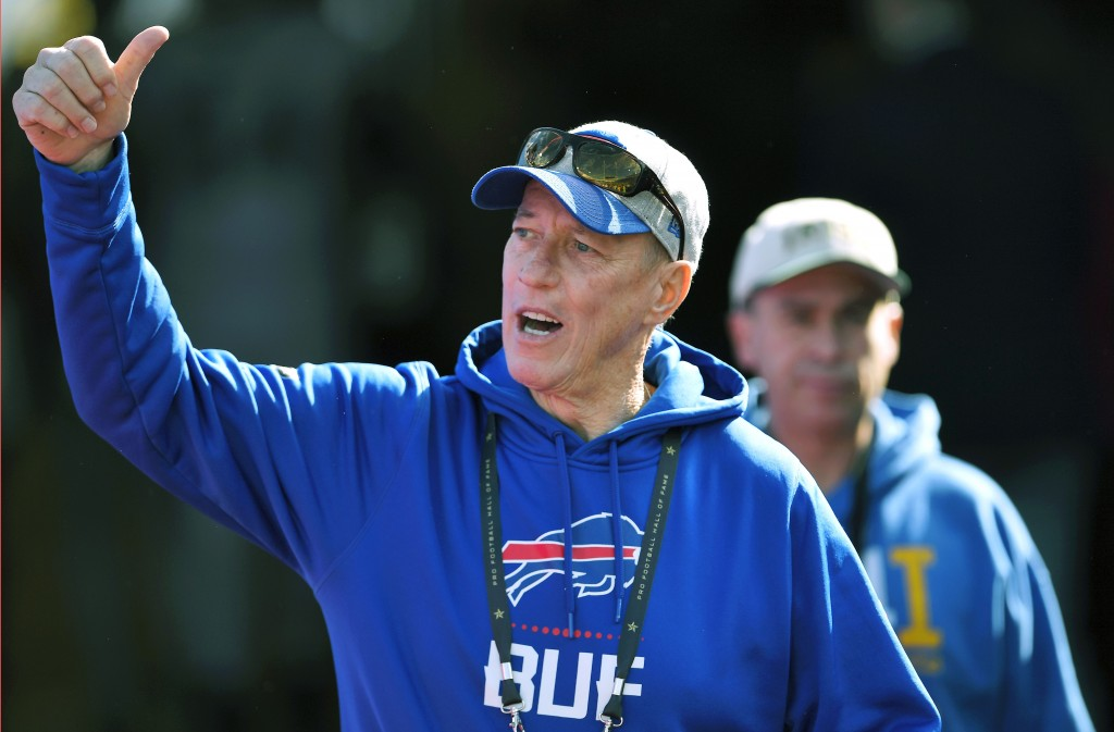 FILE - In this Oct. 20, 2019, file photo, former Buffalo Bills quarterback Jim Kelly walks on the field before an NFL football game between the Bills ...