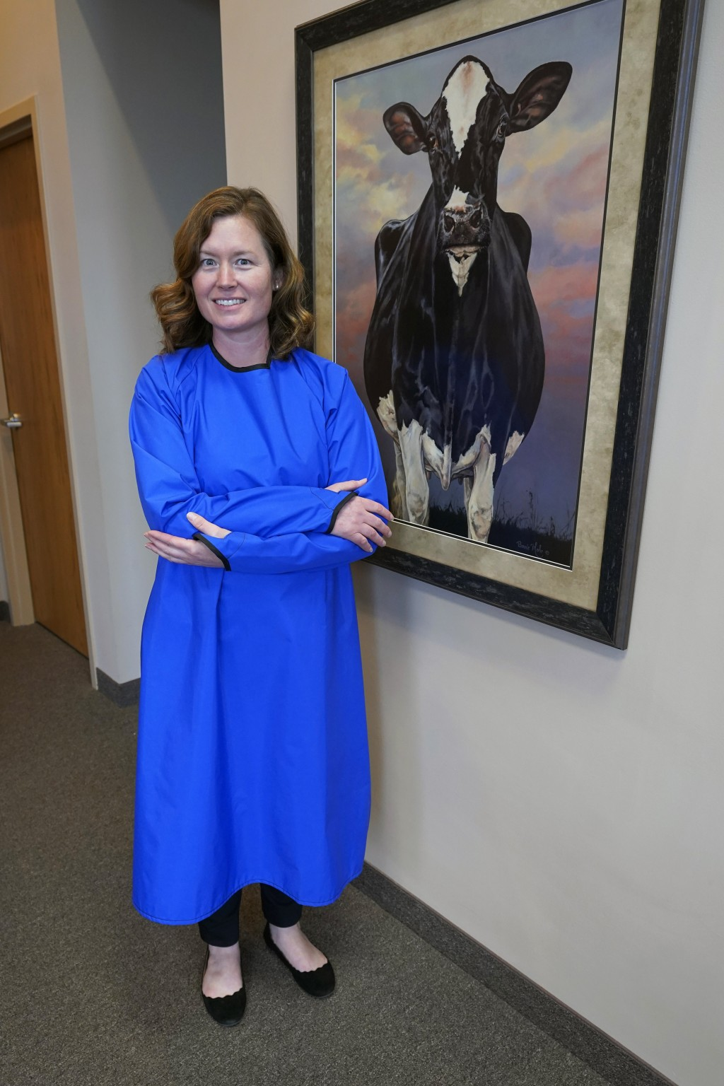 ADVANCE FOR RELEASE SATURDAY, DEC. 19, 2020 AND THEREAFTER -  Ann Quigley poses Tuesday, Dec. 15, 2020, in a waterproof gown intended for milking cows...