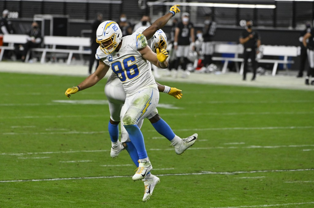 Los Angeles Chargers tight end Hunter Henry (86) and running back Joshua Kelley (27) celebrate after a teammate recovered a Los Angeles Chargers fumbl...