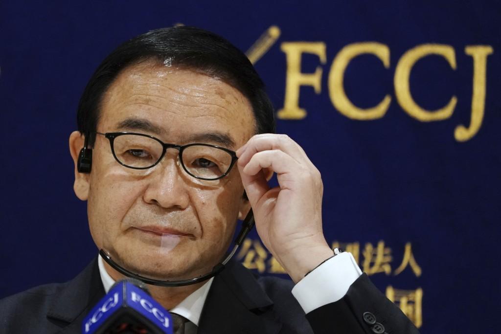 Kusatsu Mayor Nobutada Kuroiwa adjusts his glasses during a news conference in Tokyo Monday, Dec. 14, 2020. Shoko Arai, a former councilwoman, was ous...