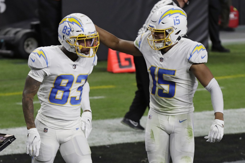 Los Angeles Chargers wide receiver Jalen Guyton (15) celebrates after wide receiver Tyron Johnson (83) scored a touchdown against the Las Vegas Raider...