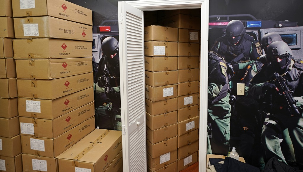 Cases of hand sanitizer are stacked on the retail floor and stored in a changing room for fitting bulletproof vests at the Body Armor Outlet store, We...
