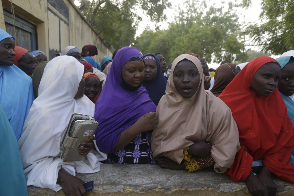 Family members of the freed schoolboys wait for a reunion in Katsina, Nigeria, Friday Dec. 18, 2020. More than 300 schoolboys kidnapped last week in a...