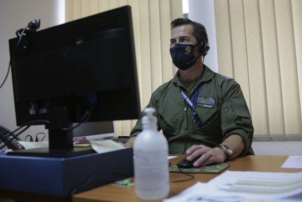 Portuguese Air Force nurse Nuno Carvalho hosts an online COVID-19 Q&A session with care home staff, from an office at the armed forces chiefs of staff...