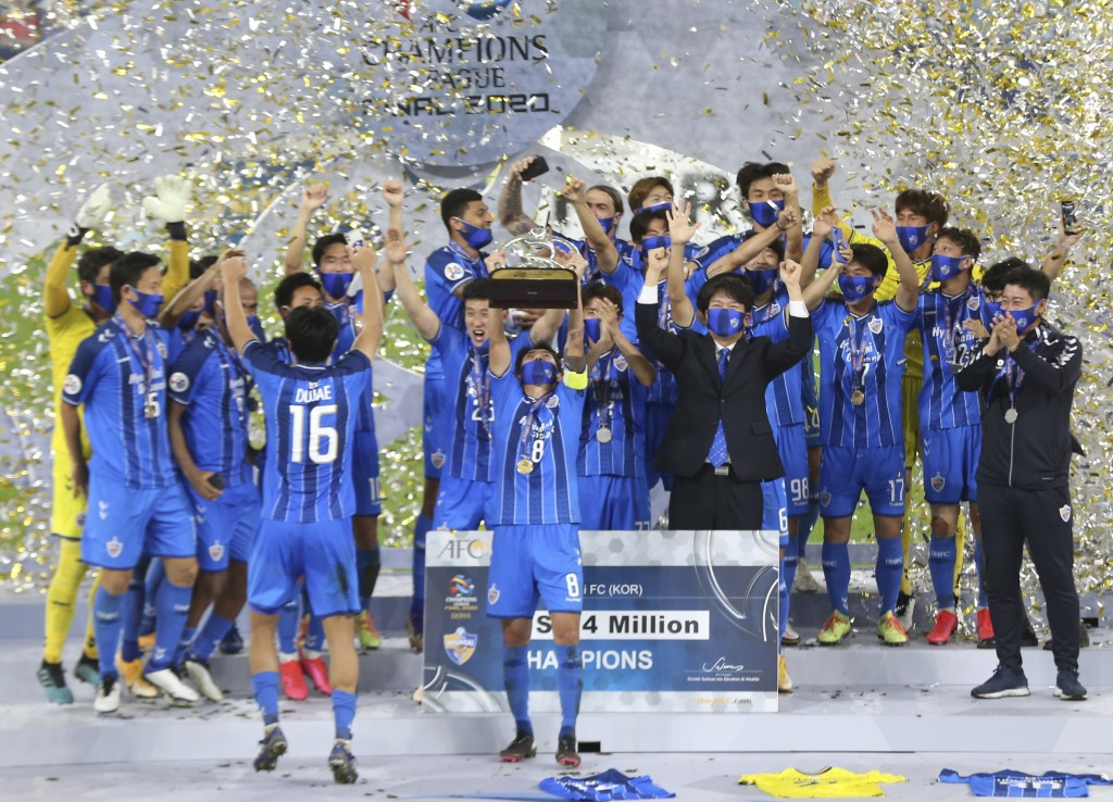 Ulsan Hyundai's players celebrate with a trophy after the AFC Champions League final match against Persepolis in Al Wakrah, Qatar, Saturday, Dec. 19, ...