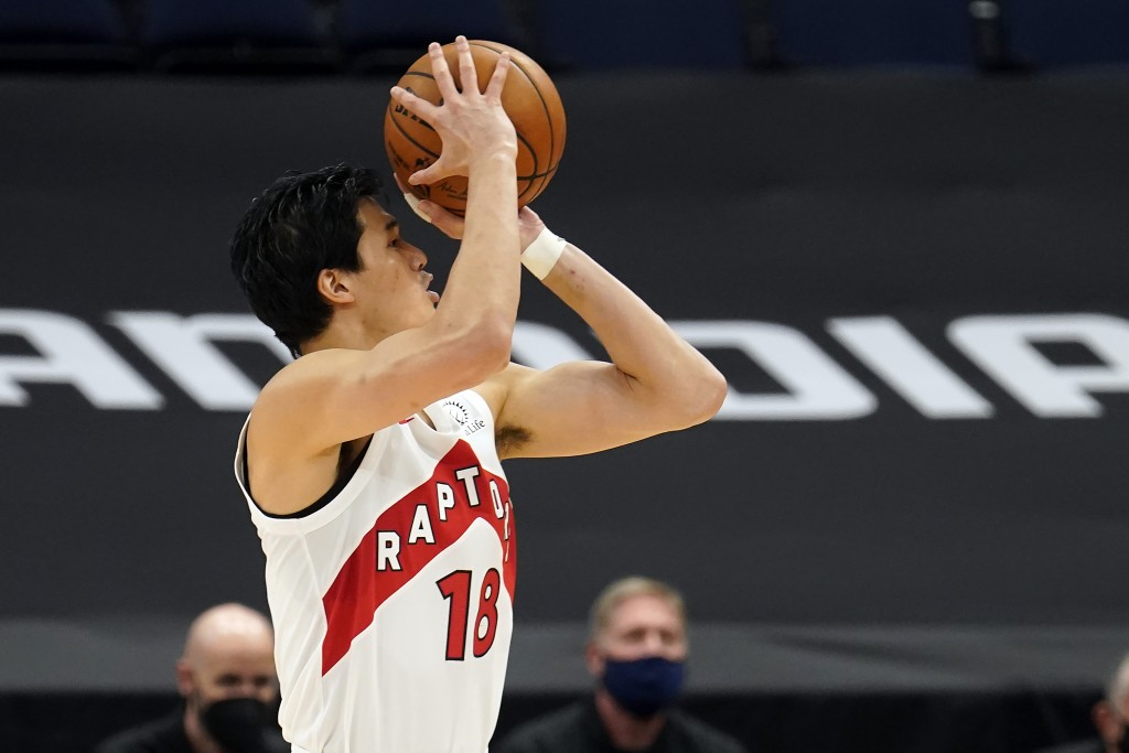 Toronto Raptors forward Yuta Watanabe, of Japan, shots against the Miami Heat during the second half of an NBA preseason basketball game Friday, Dec. ...