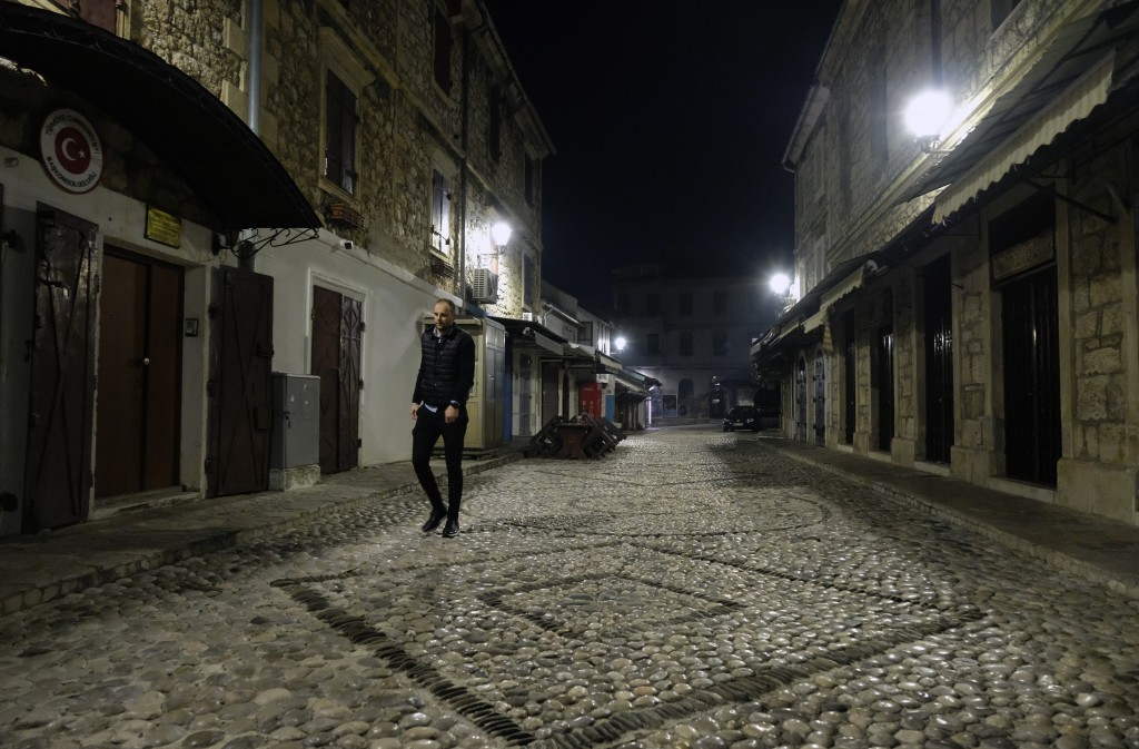 A man walks in the center of Old City of Mostar, Bosnia, Friday, Dec. 18, 2020. Bosnia's ethnically divided southern city of Mostar is holding its fir...