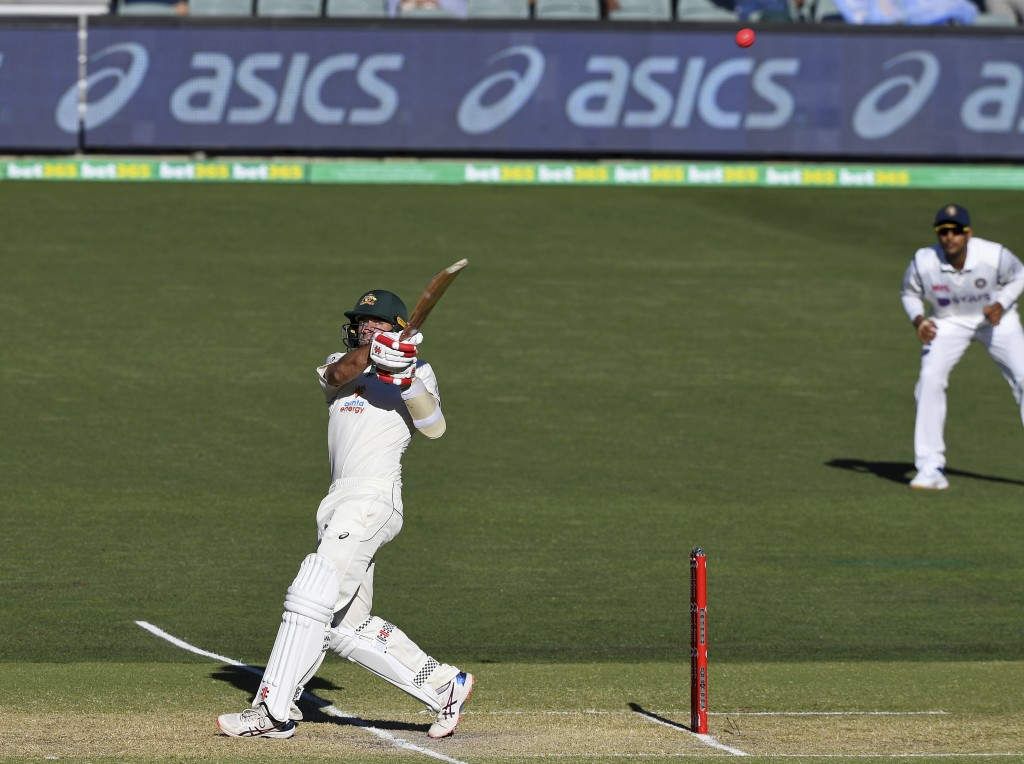 Australia's Joe Burns, left, his a 6 to win their cricket test match against India on the third day at the Adelaide Oval in Adelaide, Australia, Satur...