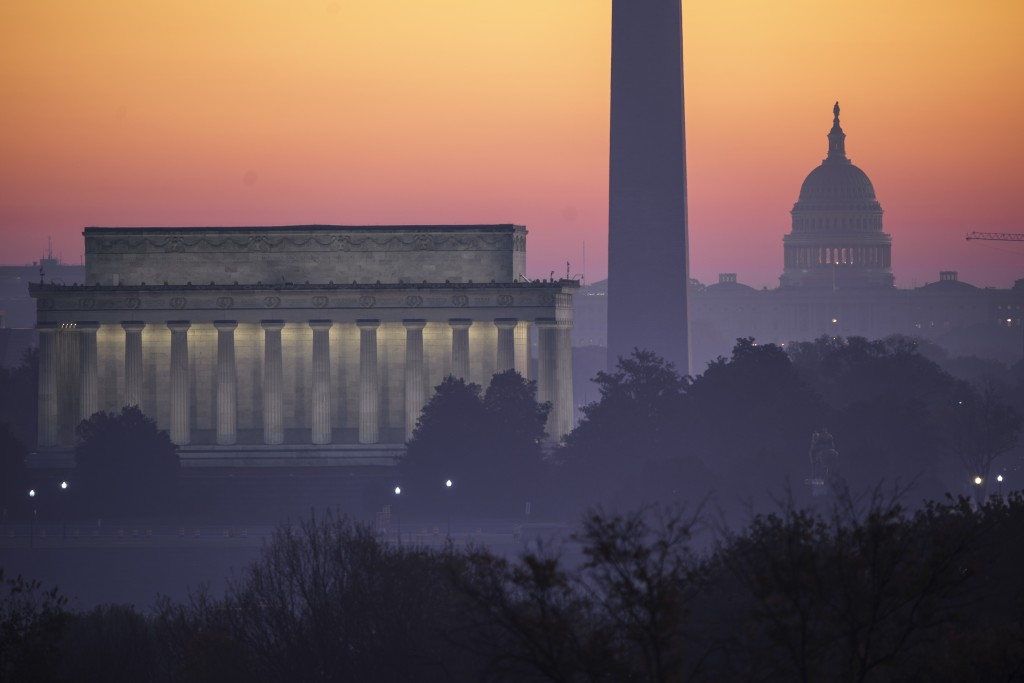 FILE - In this Nov. 8, 2020, file photo, the Washington skyline is seen at dawn with from left the Lincoln Memorial, the Washington Monument, and the ...