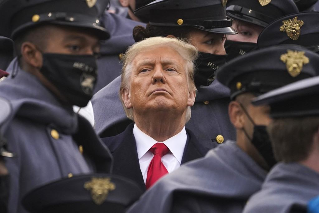 Surrounded by Army cadets, President Donald Trump watches the first half of the 121st Army-Navy Football Game in Michie Stadium at the United States M...