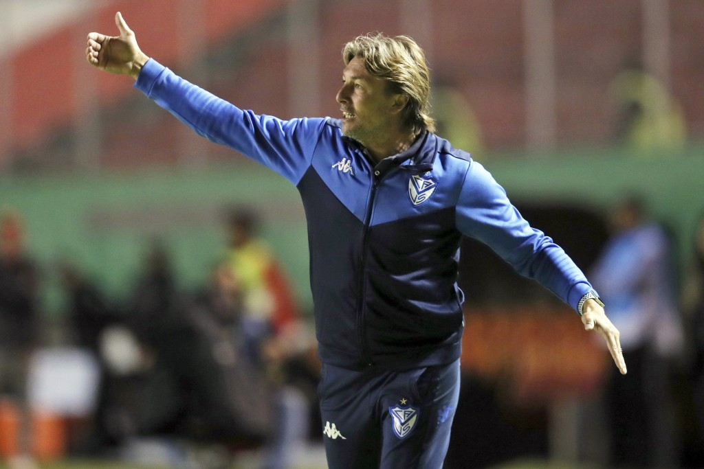 FILE - In this Feb. 18, 2020, file photo, Velez Sarsfield coach Gabriel Heinze directs his players during a Copa Sudamericana soccer match against Auc...