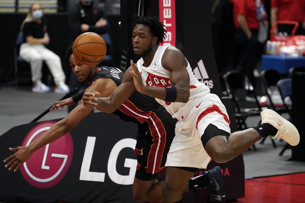 Toronto Raptors forward OG Anunoby (3) and Miami Heat forward KZ Okpala (4) batle for a rebound during the first half of an NBA preseason basketball g...