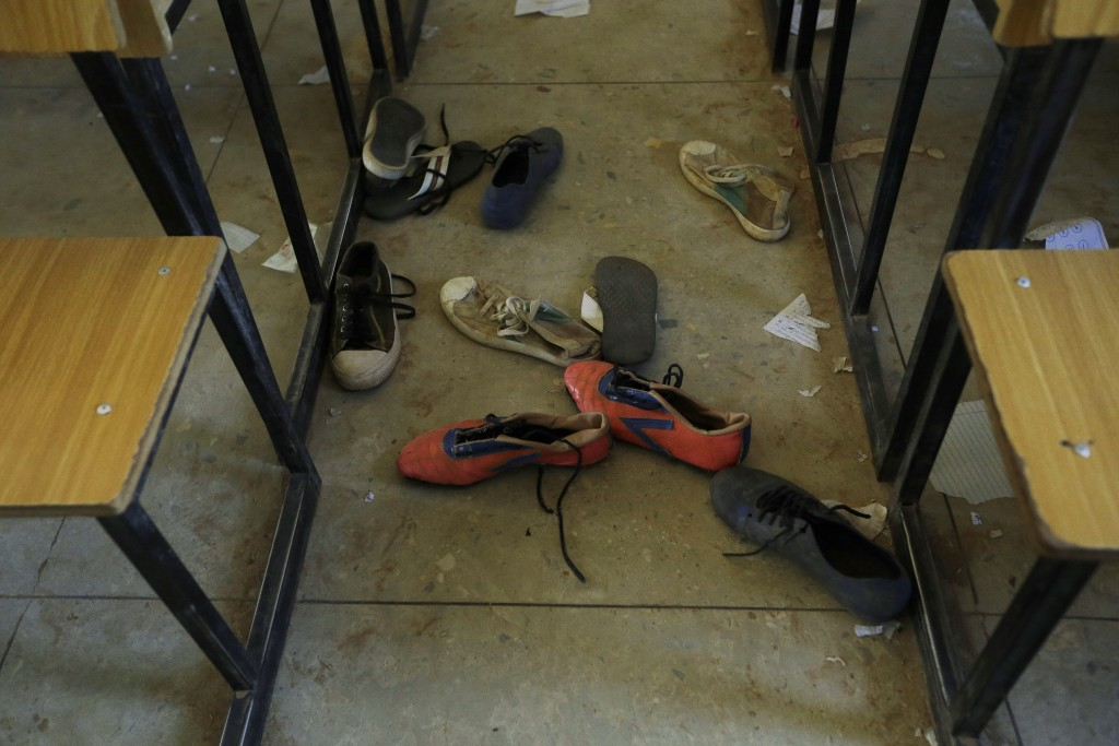 Shoes of the kidnapped students from Government Science Secondary School are seen inside their classroom Kankara, Nigeria, Wednesday, Dec. 16, 2020. R...